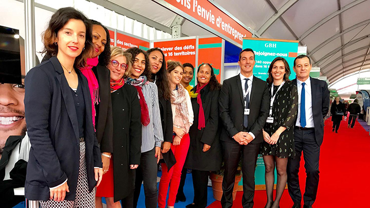 HR directors and managers team in the French Overseas pavilion at the Paris employment fair